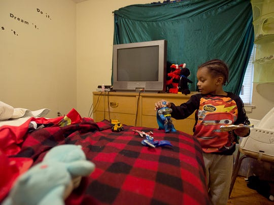 Zyheim Ponder, 5, son of Maria Taylor, plays with his