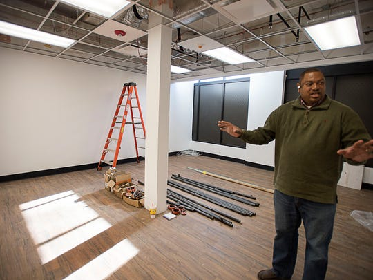 Micheal Woods, executive director of Western Carolina Rescue Ministries, shows off what will be a new shelter area for women and children. For three years, Western Carolina Rescue Ministries has worked to raise nearly $740,000 to renovate its space.