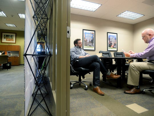 Jeremiah Smith, left, listens to questions Jeffrey Cox has about a software system he is in the process of creating and selling as they meet through Elevate, a professional mentorship program launched by Venture Asheville, at the Asheville Chamber of Commerce offices on Wednesday. Cox is among the first 10 entrepreneurs to be accepted into the newly launched program.