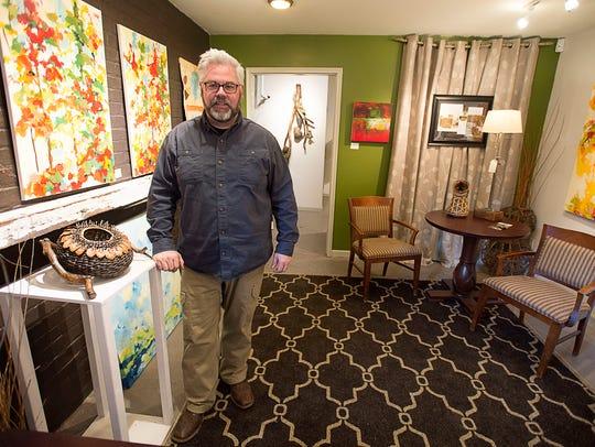 Sculptural basketry artist Matt Tommey stands next