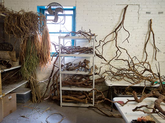 Materials used for sculptural basketry artist Matt Tommey's work are stored inside his gallery and studio at the Riverview Station.