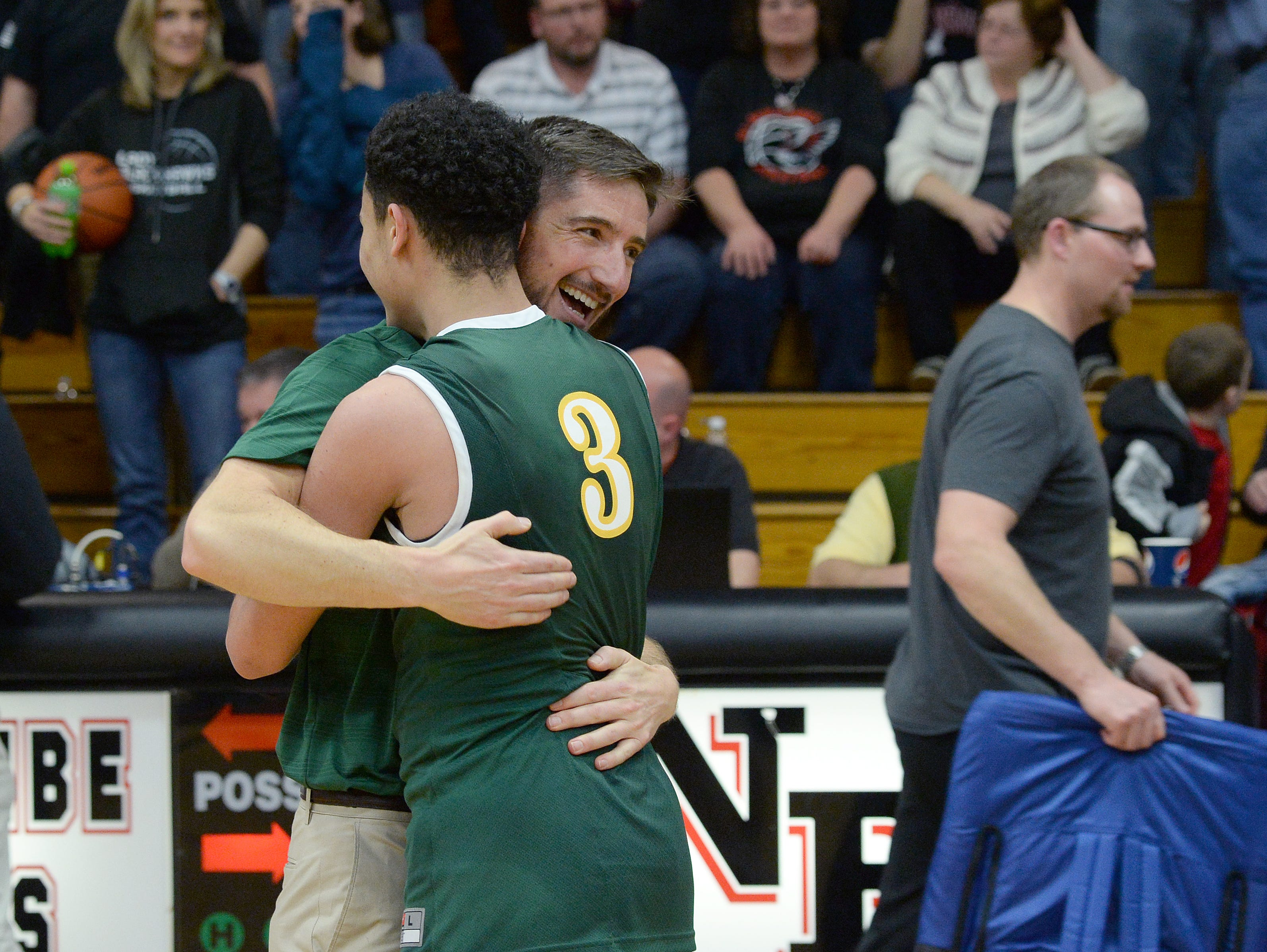 Reynolds basketball coach Clint Loftin hugs Josh Jones after last Friday's 66-61 overtime win at North Buncombe.