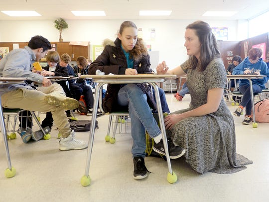 Student teacher Kaitlyn Mattiace helps student Jayselynn Espada, 15, with a math problem while teaching a Math 1 class at A.C. Reynolds High School on Friday. Mattiace is a senior at the University of North Carolina Asheville and plans to stay in the area to teach after graduating.