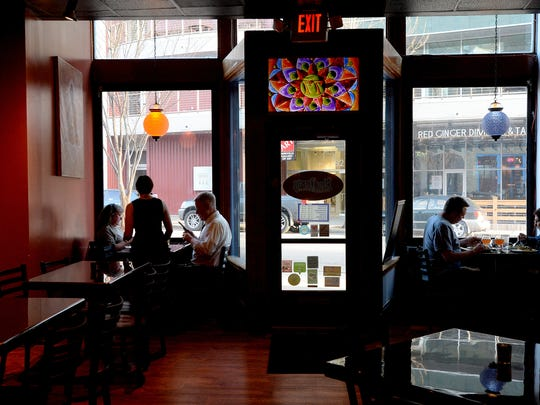 Server Christine Troianello tends to tables at Blue