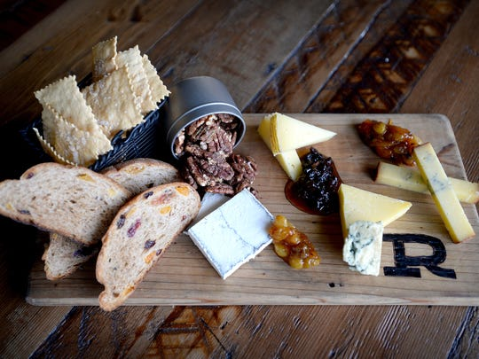 A bread a cheese plate from The Rhu includes house-made saltines, bread and a variety of cheeses.