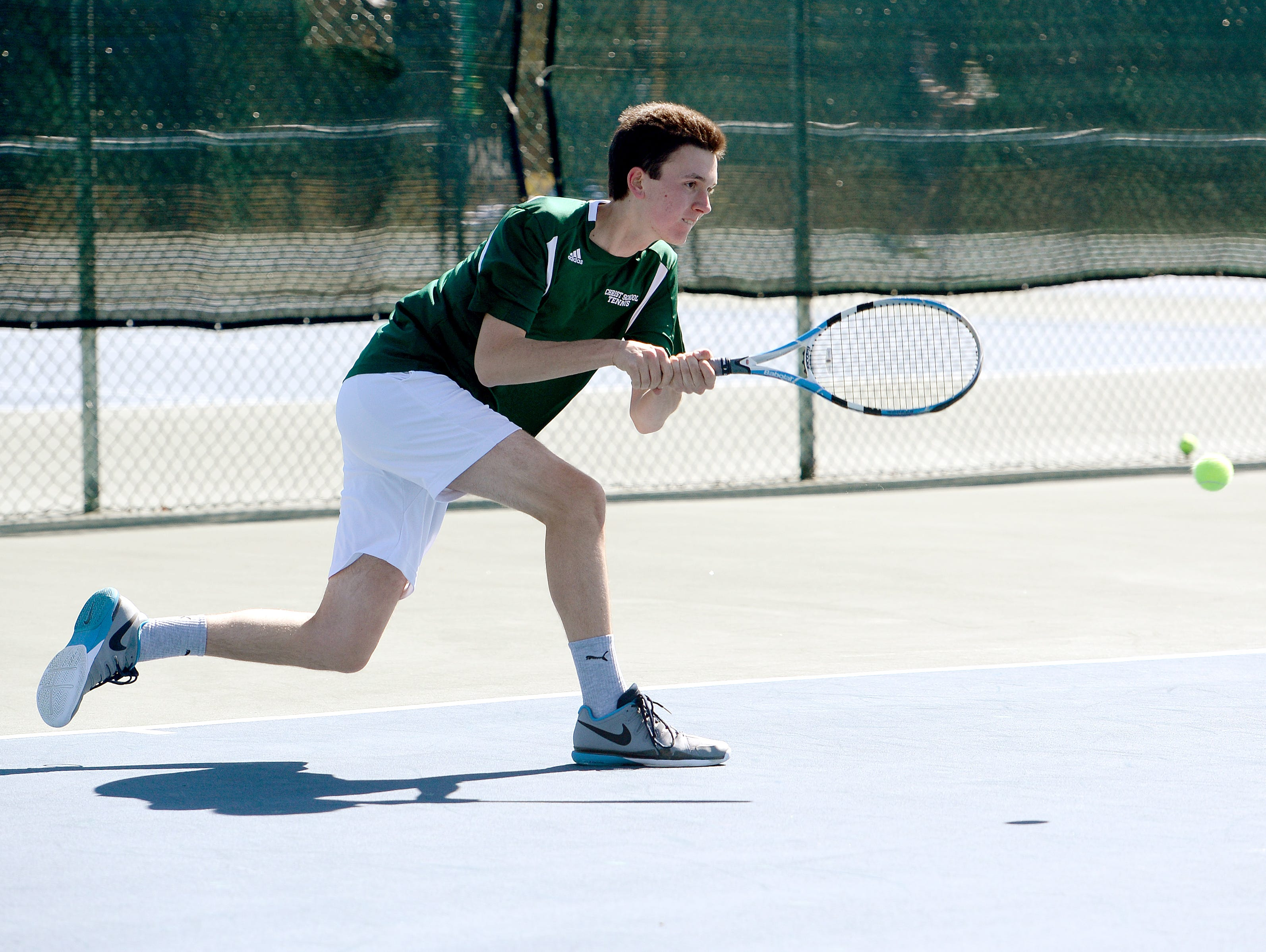 Christ School's Kiffen Loomis returns a shot during Tuesday's home match against Asheville School.