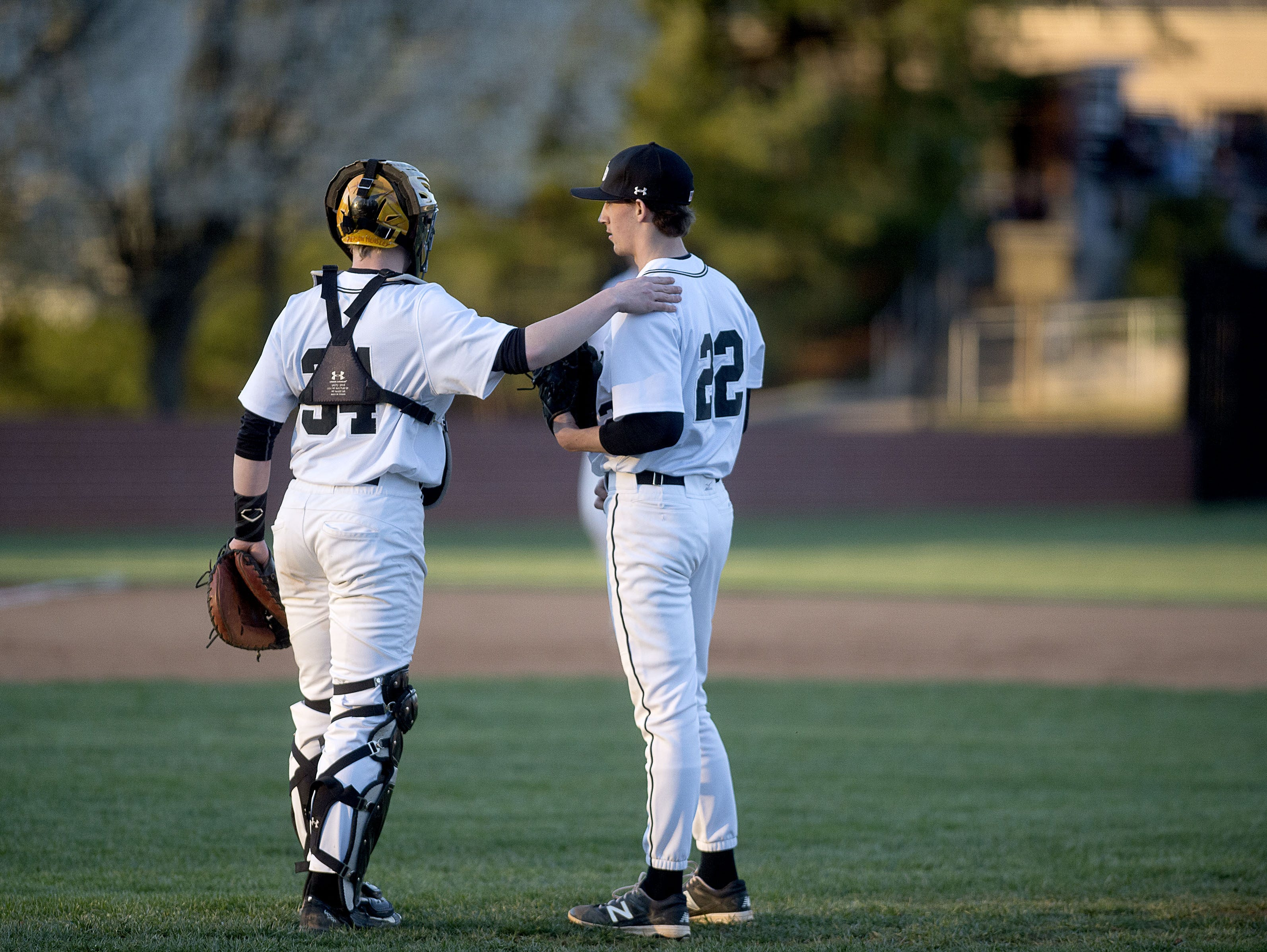 North Buncombe baseball players Pierson Hensley (34) and Robert Rogers (22).