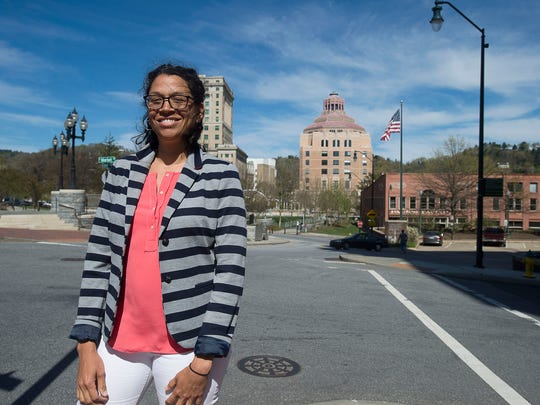 Amber Weaver, the director of the city's Office of Sustainability, stands by Pack Square at the corner of South Market Street Friday April 15, 2016.