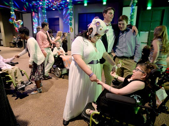 PEP student Alma Carrillo dances with Erin Pickel during the PEP prom at Biltmore Baptist Church on Friday, April 15, 2016.