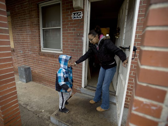 Maria Taylor and her 5-year-old son, Zyheim Ponder, go inside their home at Lee Walker Heights in this 2016 photo.