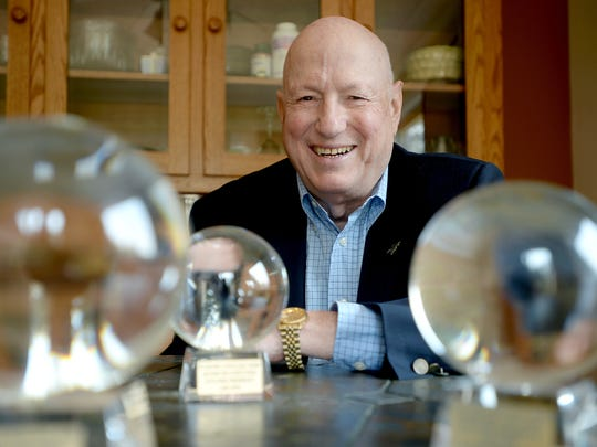 James Smith, chief economist at Asheville-based Parsec Financial Inc., poses with his three crystal ball awards at his home on Wednesday, April 27, 2016. Smith will be speaking and giving business and financial forecasts at the annual Economic Crystal Ball Seminar at UNC Asheville for the 30th time on Thursday.