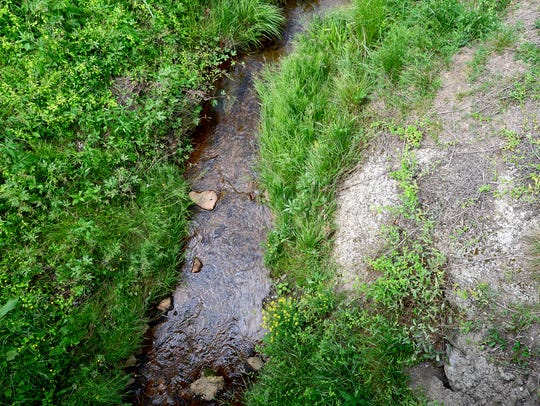 Water flows in a tributary of Hominy Creek that runs