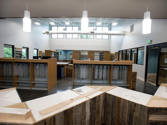 The pharmacy counter is one of the last few items to be finished up at Sona Pharmacy and Clinic in East Asheville.