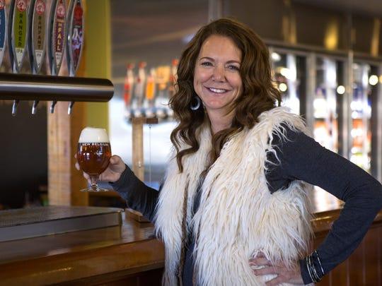 New Belgium co-founder Kim Jordan holds a Ranger IPA