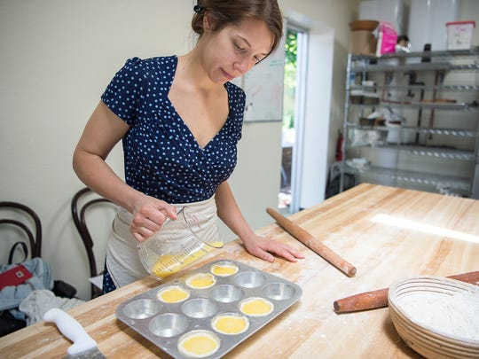 Susannah Gebhart carefully pours custard into the natas