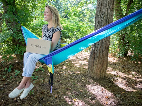 Founder of BANGS Shoes Hannah Davis sits in a ENO Hammock in Carrier Park July 12, 2016.