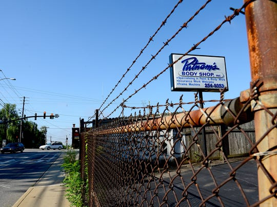 The property currently operated by Putnam's Body Shop on Haywood Road will become part of a new development along Beacham's Curve in West Asheville.