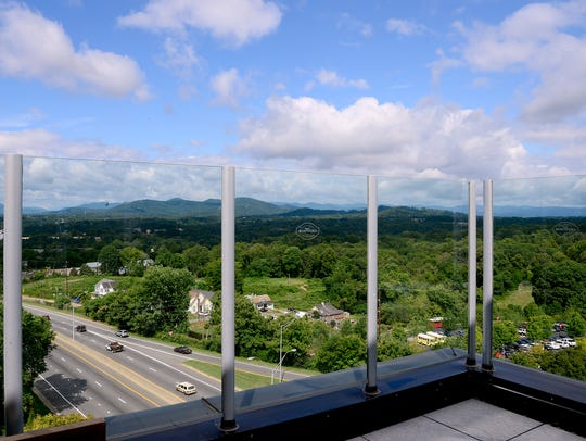 The Montford, the rooftop bar at the top of the Hyatt Place Asheville Downtown, features expansive views to the west and north.