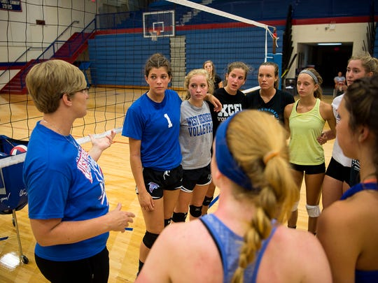 Coach Tiffany Lowrance speaks to her team in between drills Thursday August 4, 2016.