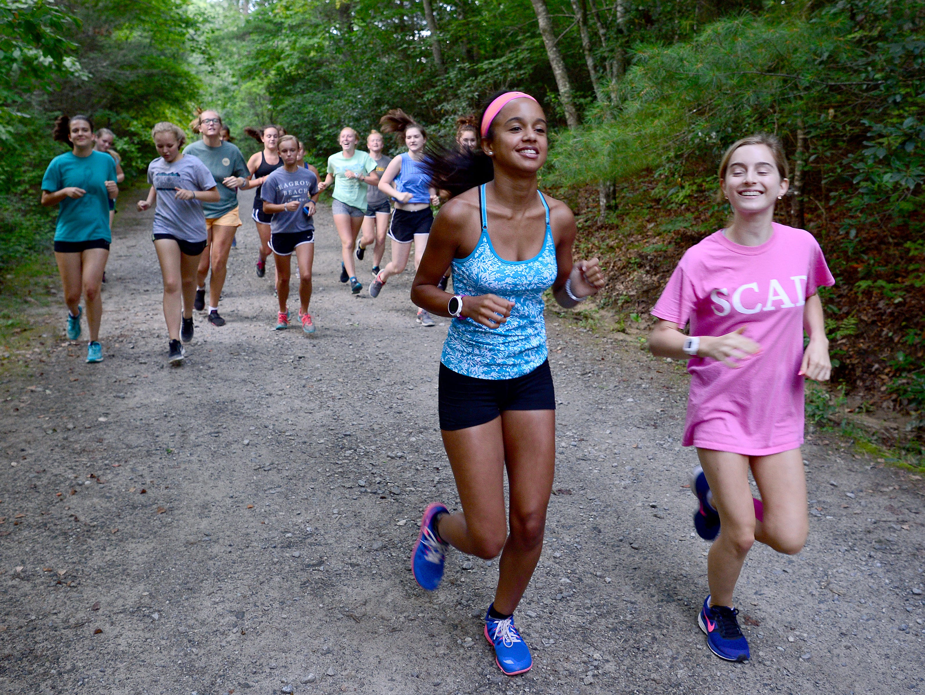Roberson cross country runners Selah Scott, left, and Emily Fine, right, lead the pack as the team does a practice run at the North Carolina Arboretum on Thursday, Aug. 4, 2016.