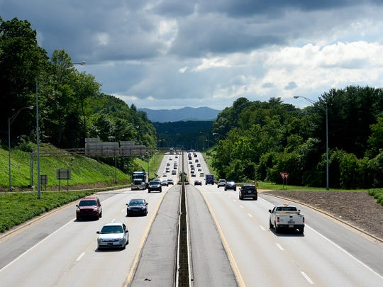 Traffic is seen making its way down I-240 in West Asheville