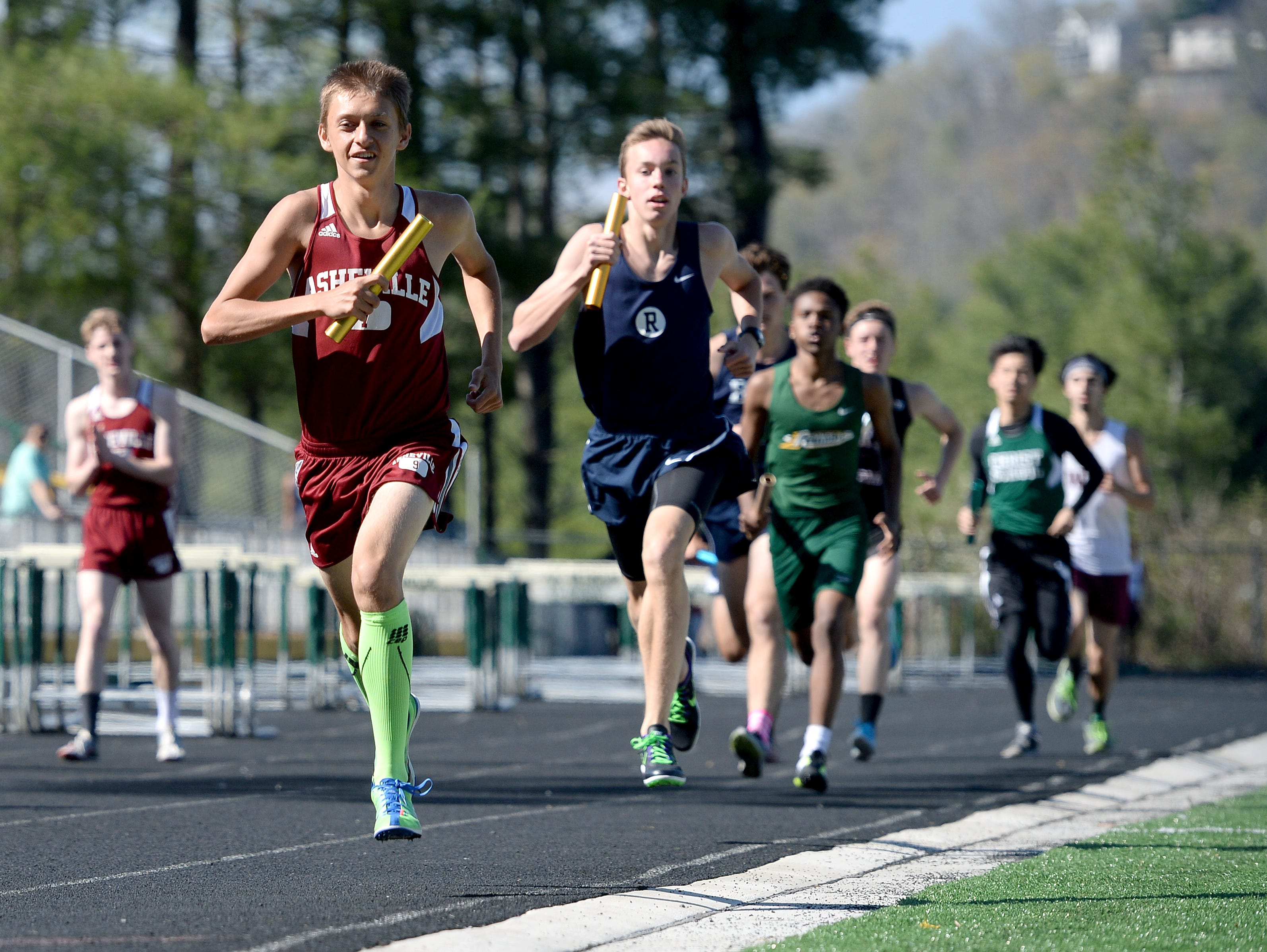 Asheville High's Haven Honeycutt, shown here during a track race last spring, is expected to be one of the top cross country runners for the Cougars.