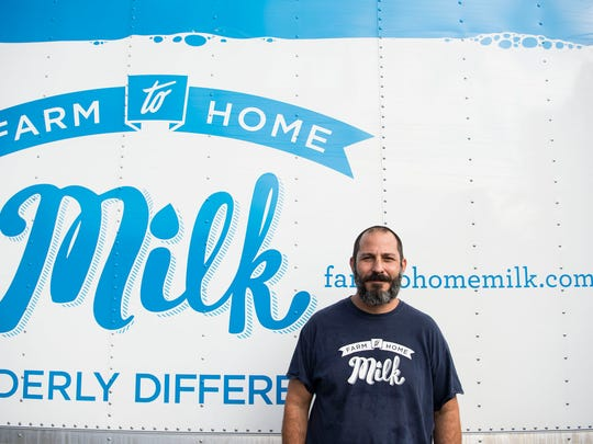 Farm to Milk founder Jonathon Flaum stands in front of one of his milk delivery trucks Aug. 17, 2016.