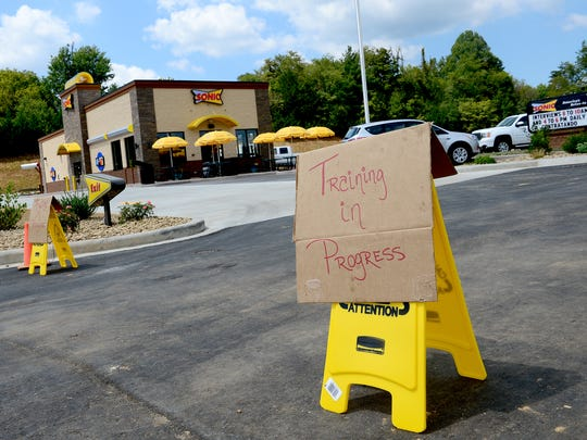 A sign states that employees of a brand new Sonic restaurant are still being trained in a development that includes a Walmart in Weaverville.