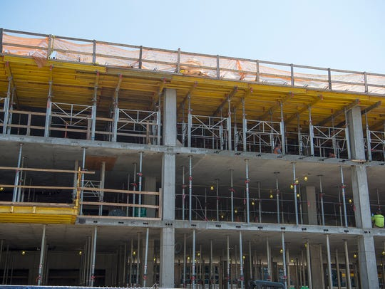 Construction continues Sept. 8 on the site of the 12-story