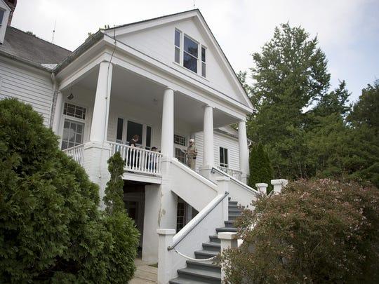 Visitors admire the Carl Sandburg home in September.