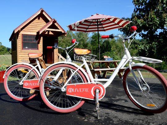 Bikes bearing the logo of Olivette, an agrihood community along the French Broad River, are one way for prospective plot-buyers to get around.