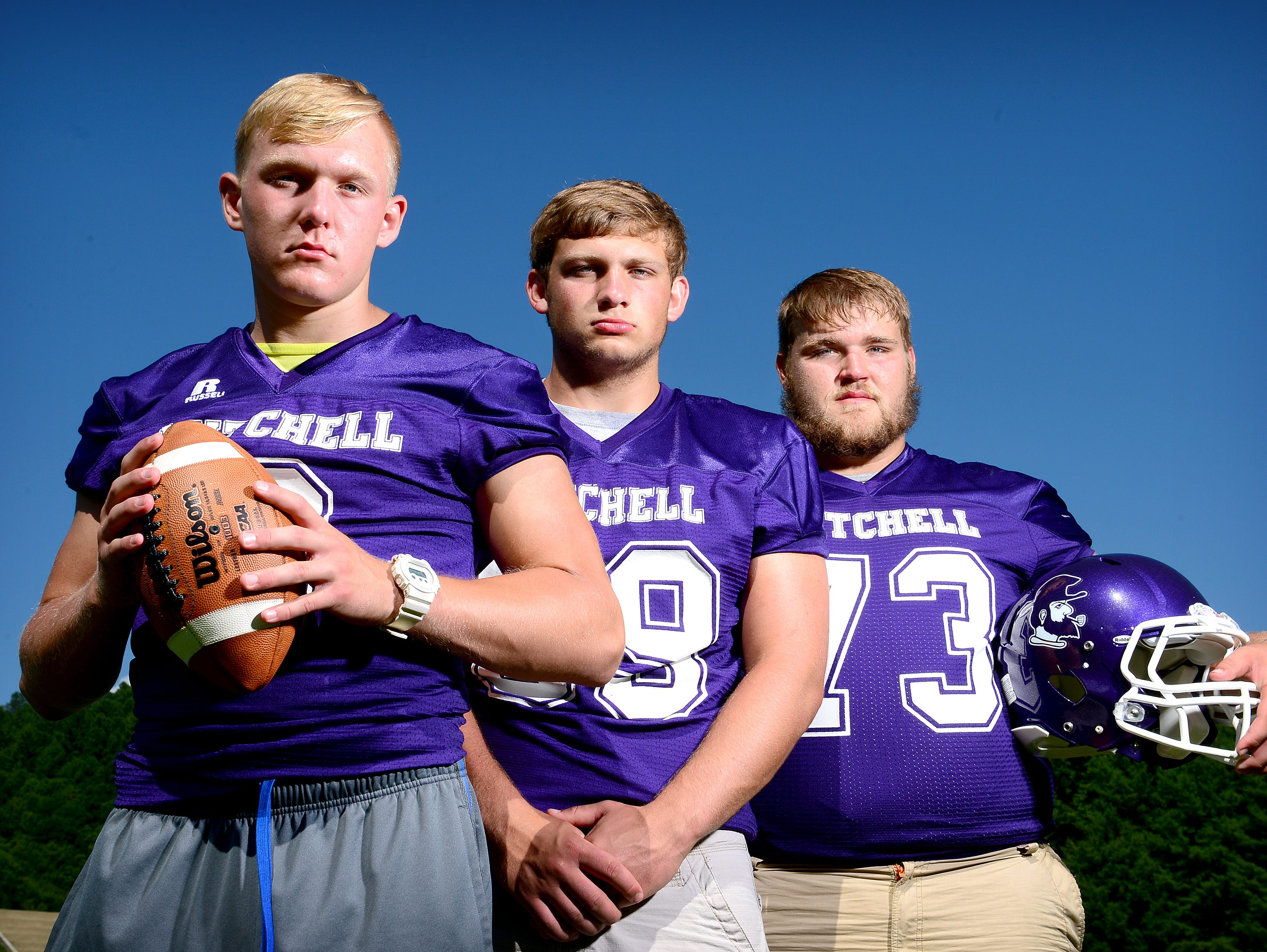 Mitchell football players, from left to right, Ben Young, Alex McKinney and Todd Self.