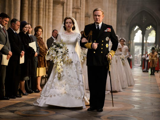 Claire Foy as Elizabeth and Jared Harris as her father,