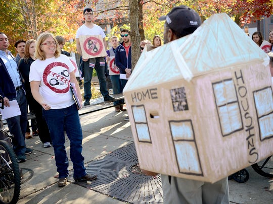 """Rev. Amy Cantrell, executive director of Be Loved House, talks addresses the group during a """"Housing not Handcuffs"""" march calling for the end of over-policing of the homeless at Prichard Park on Tuesday, Nov. 15, 2016."""
