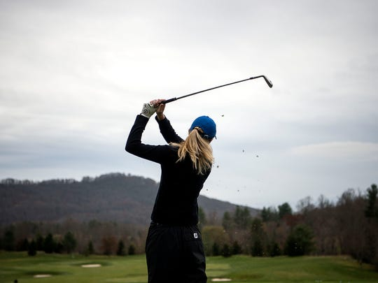 Freshman UNCA student Linna Brooks works on her drive in between fall and spring golf seasons Dec. 5, 2016 in Arden.