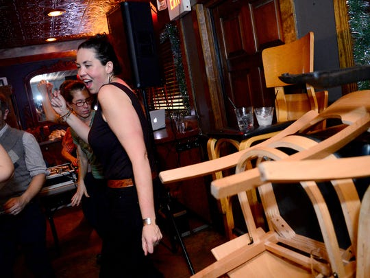 Chairs and other restaurant furniture are pushed to the sides of The Admiral to make room for dancers such as Cathryn Davis Zommet, left, during the Saturday night dance party at the West Asheville restaurant on Saturday, Dec. 17, 2016. After nine years of hosting the after-hours parties, New Years Eve will be the final event.