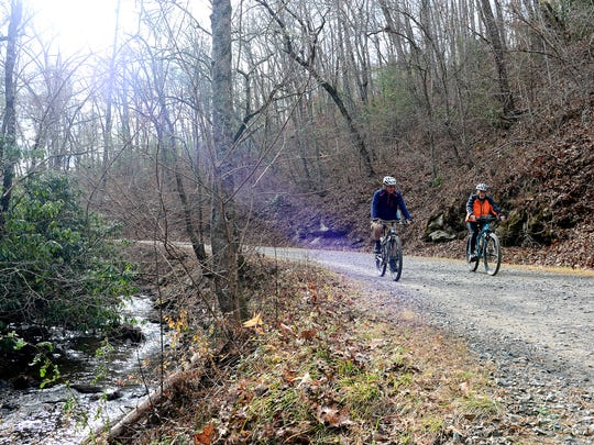 Bicyclists ride down Bent Creek Road at the North Carolina Arboretum on Saturday, Dec. 17, 2016. The parking fee at the Arboretum will be waved over the holiday weekend for people wanting to use the trails although the buildings will be closed.