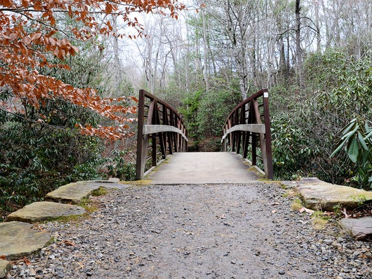 A bridge on the Old Mill Trail leads visitors of the North Carolina Arboretum to even more of their more than 10 miles of trails.
