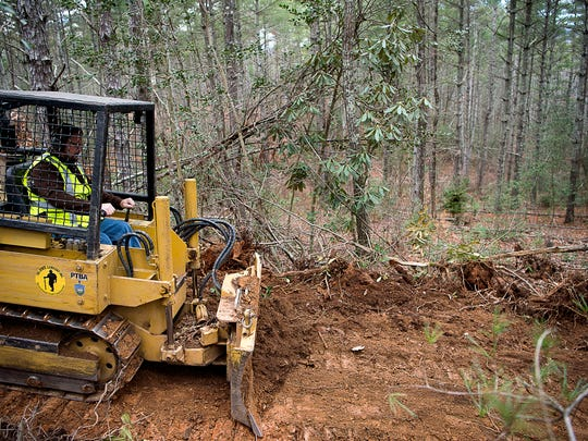John Gibson of Tri-State Co., Inc. out of West Virginia, works on creating a section of the Fonta Flora Trail at Lake James State Park Wednesday Jan. 4, 2017.