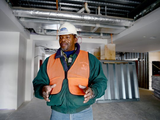 Horace Adell, president of Clean Streak Inc., talks about his business, which does industrial cleaning such as post-construction, in the lobby of a job site in Hendersonville. Adell's business is one of the few black-owned businesses that received contracts for work with the city of Asheville in 2015.