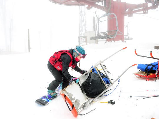 Indigo Hollister, 18, prepares a rescue sled to give a demonstration on how people are transported down the mountain at the top of The Bowl at Wolf Ridge Ski Resort on Wednesday, Jan. 11, 201. Hollister is a member of the ski patrol who give immediate assistance to hurt customers on the slope.