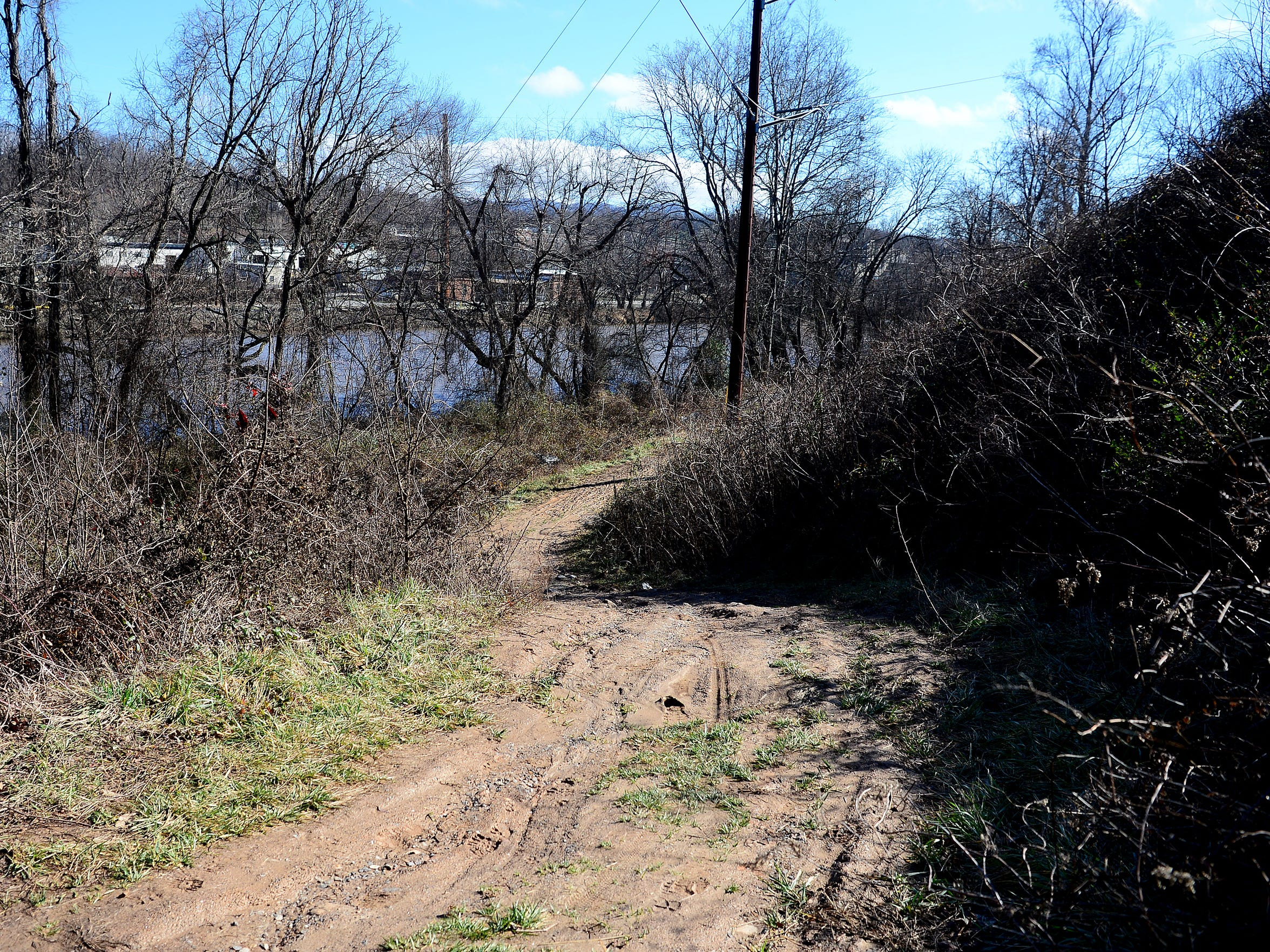 A dirt path marks what will soon be an extension of the French Broad River Greenway running from Haywood Road in the River Arts District along the river to connect with existing greenway at the French Broad River Park on Amboy Road.