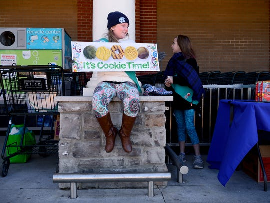 Abigail Blanton, 10, sits on a pillar advertising cookie