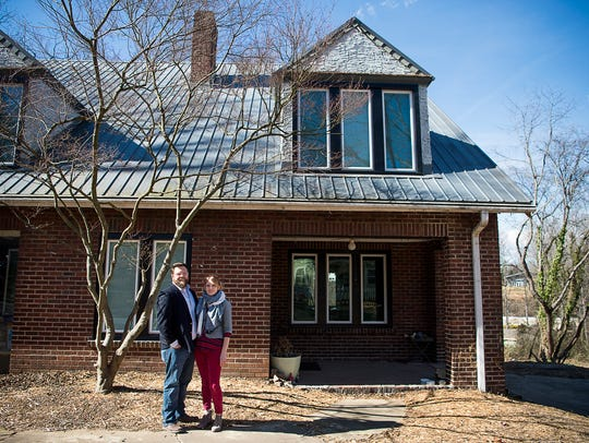 Homeowners Adam Reagan and wife Brianna Ganskopp stand