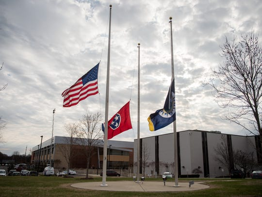 Flags are flown at half-staff outside the Madison precinct