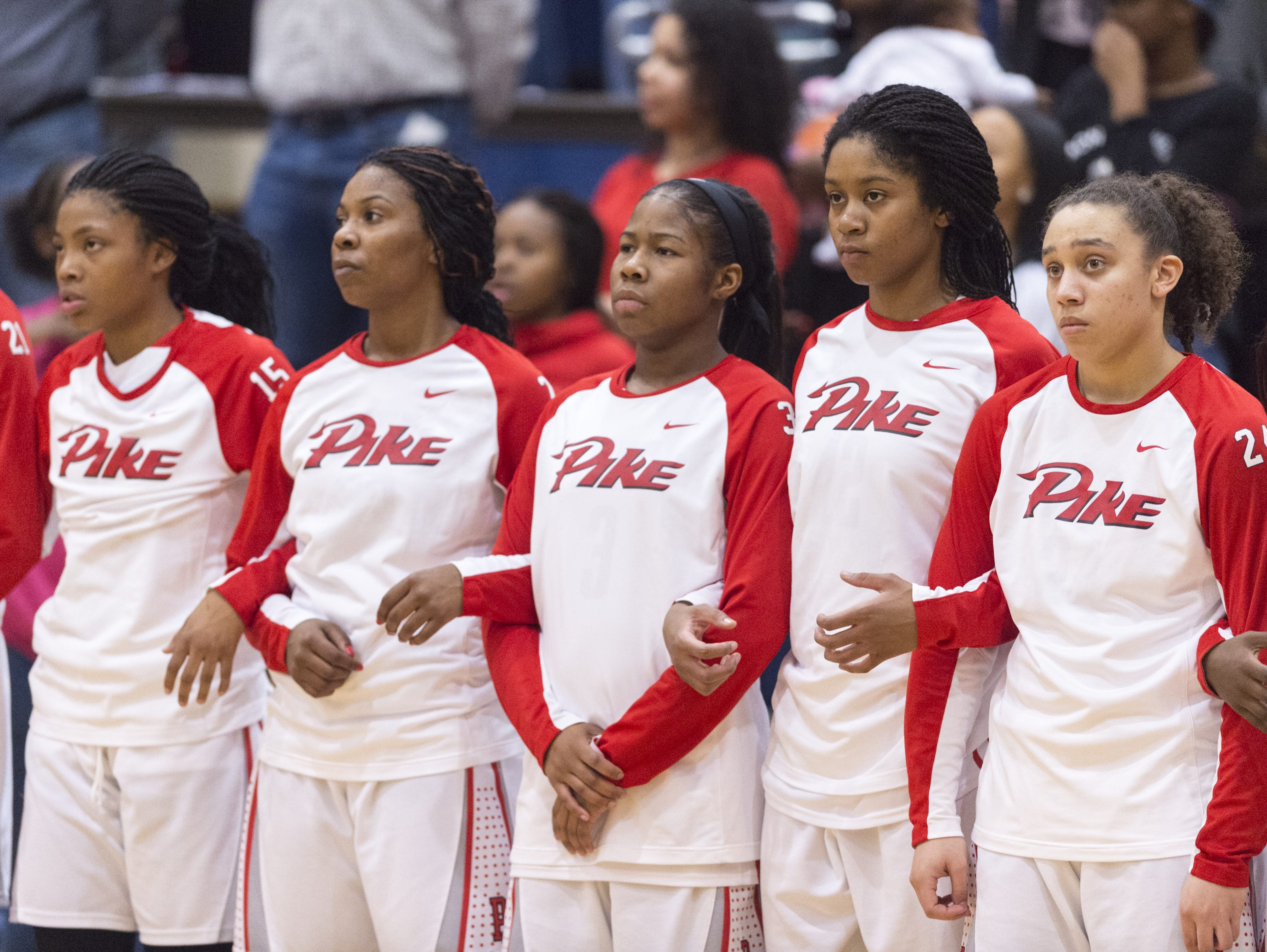 The Pike team come together for the playing of the National Anthem before the first half of the IHSAA 4A Girls' Basketball Tournament Regional championship game, Feb. 11, 2017, at Decatur Central High School.