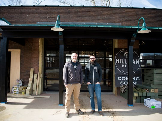 Hillman head brewer Brad Hillman, left, and Brandon Murry, right, co-owner of Rise Above Deli with Montana Fain, stand in front of the space that will be home to Rise Above Deli and Hillman Brewery.