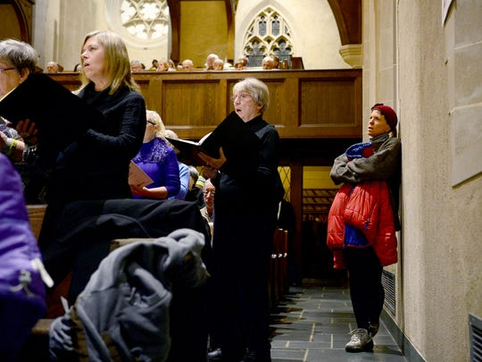Becky Kluge joins in the singing of the Requiem Mass