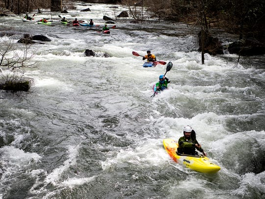 Whitewater kayakers paddle the Cheoah River in Graham
