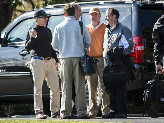 Sen. Rand Paul, R-Ky., (left), Mick Mulvaney, director of the Office of Management and Budget (center) and White House Chief of Staff Reince Priebus (right) converse after returning to the White House from a round of golf with President Trump at his golf course, Trump National in Virginia on April 2, 2017.
